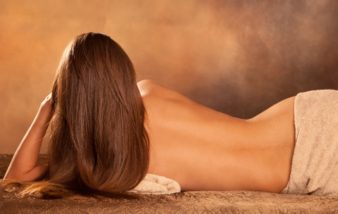 beautiful woman back lie in spa salon